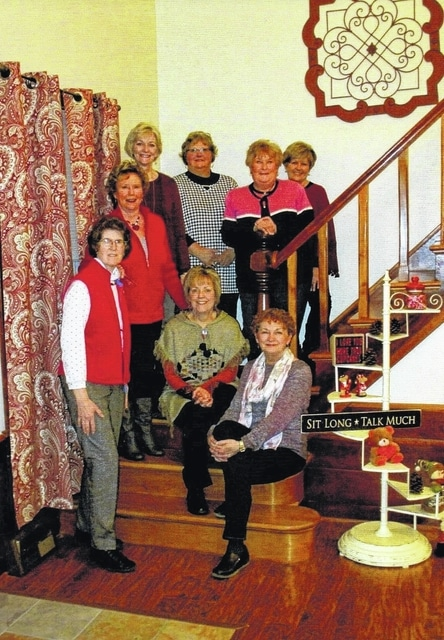 The Deer Creek Daisies Garden Club celebrated February's Valentine's Day occasion with an evening of food, fellowship and flowers. Pictured: seated on steps, Marty Cook and Rita Lanman; from bottom to top of stairs are Barbara Vance, Connie Lindsey, Emily King, Joyce Schlichter, Kendra Knecht and Billie Lanman.