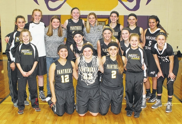 2015-16 SCOL CHAMPIONS, MIAMI TRACE — McClain High School, and specfically athletic director Pat Stevens, graciously allowed the Lady Panthers to cut down a net at McClain Saturday following a 33-29 win by Miami Trace over the Lady Tigers. Miami Trace won the outright SCOL championship with a record of 13-1. (front, l-r); seniors Harmonee Napier, Alexis Schwartz and Kyla Johnston and ball girl Audrey Craig; (middle, l-r); ball girl Hillary McCoy, Hanna Reisinger, Cassidy Lovett, Becca Ratliff and Tori Evans; (back, l-r); ball girl Audrey Craig, Rachael Campbell, Tori Riley, Samantha Ritenour, Tanner Bryant, Victoria Fliehman, Morgan Miller and Olivia Wolffe.