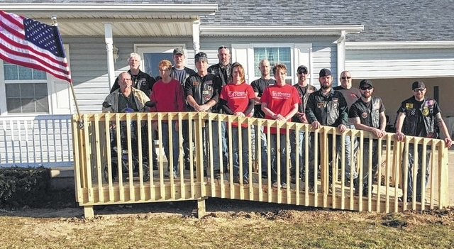 The VFW Riders started early Saturday morning at the home of Larry and Carol Brown who were in dire need of a wheelchair ramp. The home, on Riverbirch Road, was not suitable for the veteran who is now wheelchair bound. Pictured in red T-shirts are representatives from Hospice of Fayette County who alerted the Riders of this issue.