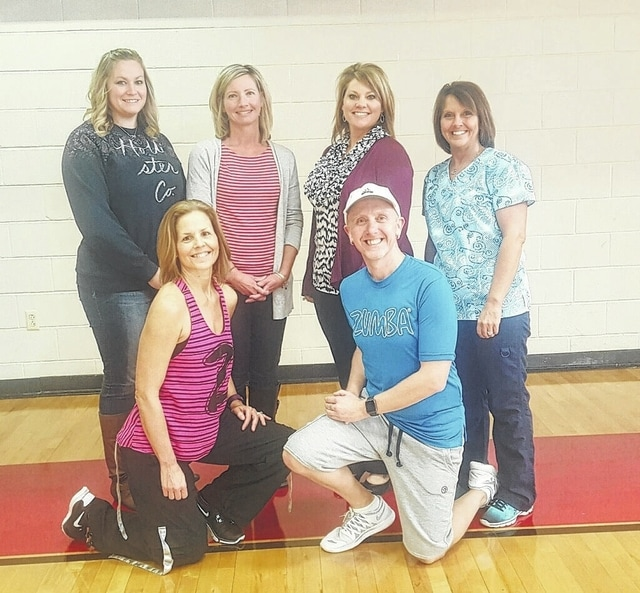Pictured are Erica Ragland, The Race committee, Holly Cottrill, Hospice of Fayette County, Chelsie Hornsby of Fayette County Memorial Hospital and Jodi Klontz, The Race committee. Kneeling are Zumba instructors, Nancy Spears and Jody Justice. Race committee members not pictured are April Self, Jeff Underwood and Amy Smith.