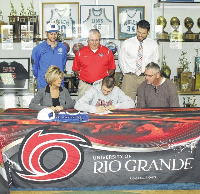 Washington High School senior Caden Cluxton signs a letter of intent to play baseball at the University of Rio Grande Wednesday, March 9, 2016. Cluxton was joined by his parents, Holly and Steve and, (standing, l-r); WHS head baseball coach Tyler Rhodus, Rio Grande head baseball coach Brad Warnimont and WHS Athletic Director Jon Creamer.