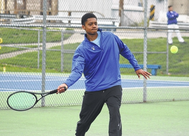Washington's Kenny Upthegrove returns a shot during a first singles match against Unioto on a chilly Monday, March 28, 2016 at Gardner Park.