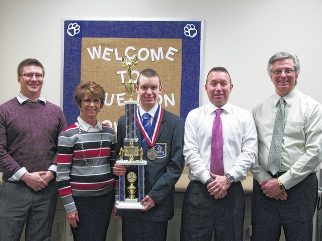 Spencer Minyo (holding trophy) won first place in his category (Principals of Marketing) during the DECA State contest held this past weekend at the Columbus Convention Center. From left to right, WHS assistant principal John Hemmelgarn, Mrs. Minyo, Spencer Minyo, WHS principal Tracy Rose, and WHS DECA coordinator David Penwell.