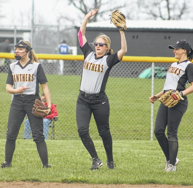 Taylor Barrett, middle, holds her glove aloft, signaling that she had come up with a diving catch in left field for Miami Trace during an SCOL game against Chillicothe Wednesday, March 30, 2016. At left is Ashley Campbell and, at right, Megan Self.
