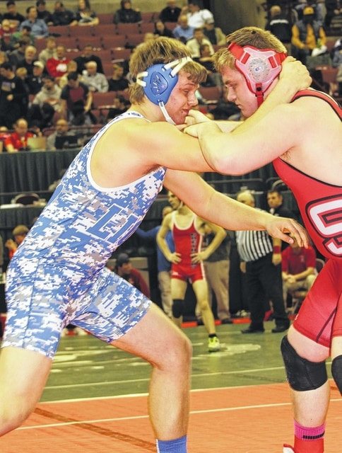 Washington High School junior Trevor Hicks, above, left, wrestles senior Michael Furbee of St. Clairsville in the opening round of the Division II State tournament (285 pounds) Thursday, March 3, 2016 at the Schottenstein Center on the campus of The Ohio State University in Columbus.