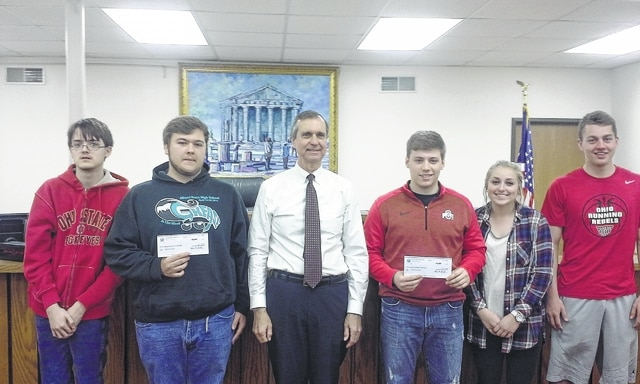 The Washington C.H. Municipal Court recently donated to the Miami Trace High School and Washington High School after prom committees. From left to right are Daryan Haffley and Brandon Brown with the Miami Trace after prom committee, Municipal Court Judge Victor Pontious, and Jacob Knisley, Jaycie McRoberts and Cameron Eckles with the Washington C.H. after prom committee. The donation for each organization was $1,500.