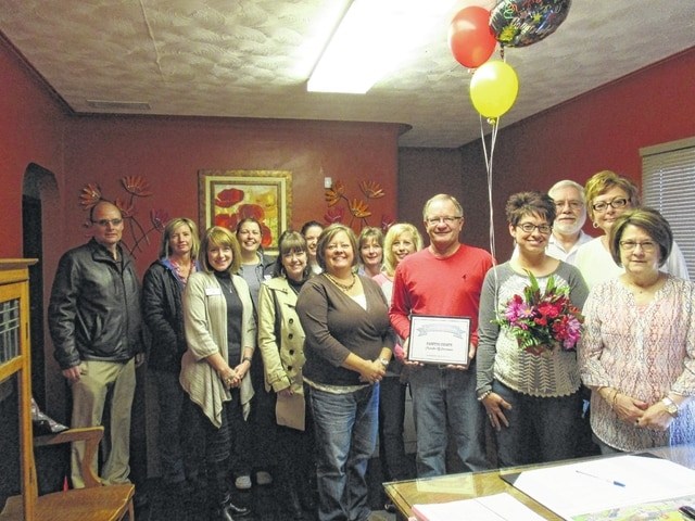 Mossbarger & Smithson CPA was honored as the first recipient of the Fayette County Chamber of Commerce Ambassador Team's Business of the Month recognition for their recent tax filing season. Pictured are members of the team presenting the business with flowers and a plaque for its hard work.