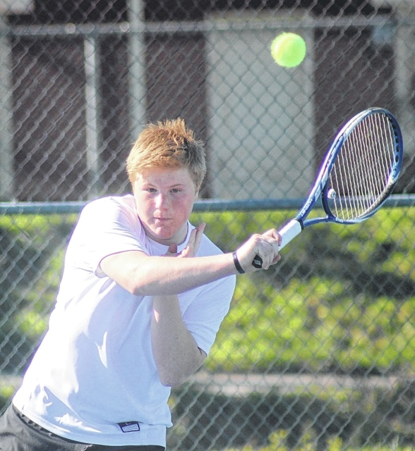 Miami Trace's Ely Schirtzinger makes the return during a third singles match against Washington's Jordan Behm at the courts at Gardner Park Wednesday, April 13, 2016.