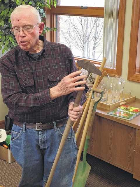 Washington Garden Club member Tom Esper demonstrating garden tools.