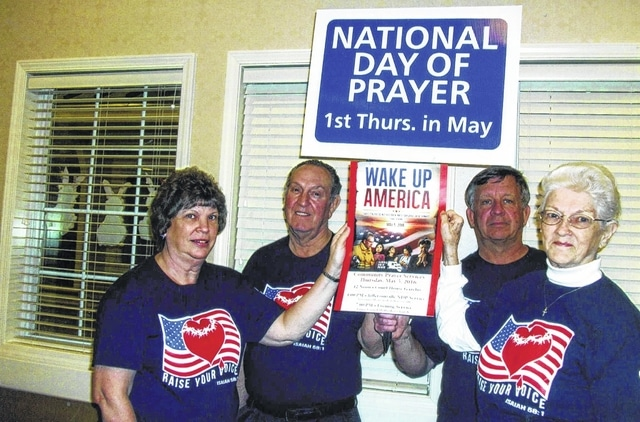 Sharon Jordan, Janey Miles, Paul Bain and Jim Boyer hold samples of the yard signs and poster.