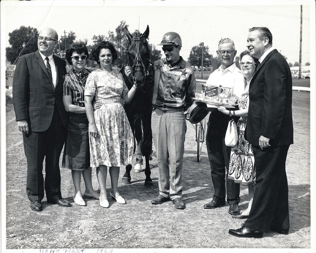 The Governor's Cup presentation to A. G. Gordon and family members in 1963. Left to right: Gene Schmidt, chairman of the Ohio State Fair; A. G.'s daughter, Edna Naylor; Virginia Gordon, wife of A. G.'s son Harold; the trotter Van's First; driver Eddie Boyer; A. G. Gordon; his daughter Donna Boyer; and James Rhodes, governor of Ohio.