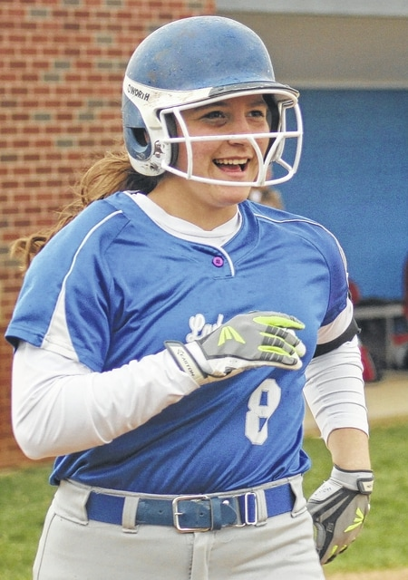 Wendy Hawk is all smiles after scoring for the Lady Lions during an SCOL game against Hillsboro Wednesday, April 6, 2016 at Washington High School.