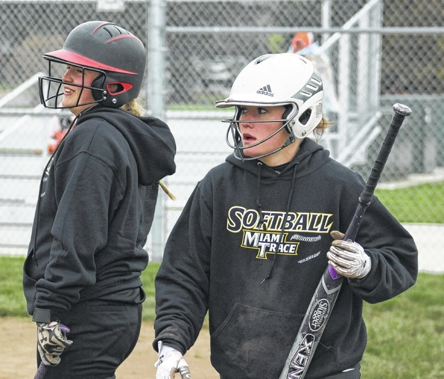 Whitney Cockerill (bat in hand) returns to the dugout after scoring for Miami Trace during an SCOL game against Wilmington Monday, April 4, 2016. Also pictured, heading to the plate, is Alexis Schwartz.
