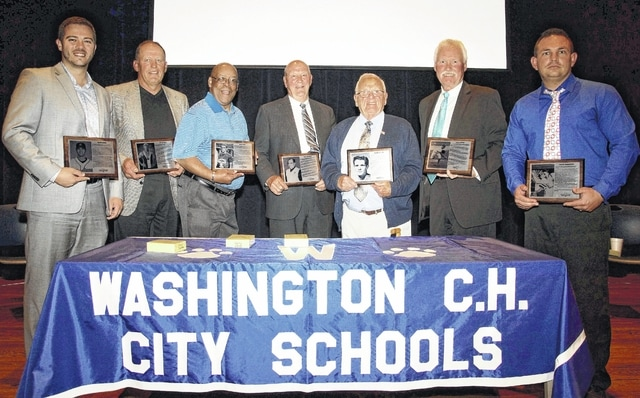 Seven new members were ushered into the Washington Court House City Schools Athletic Hall of Fame at the 13th induction ceremony held Saturday, May 14, 2016 at Liberty Hall on the campus of Washington High School. (l-r); Scott Lewis, Tim Walters, Gary Card, Gary Shaffer, Roger McLean (represented by Bill Martin, pictured), Kyle Brown (represented by his father, Keith, pictured) and Travis Robertson.