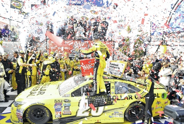 Matt Kenseth, center, celebrates in Victory Lane after he won the NASCAR Sprint Cup series auto race, Sunday at Dover International Speedway in Dover, Del.