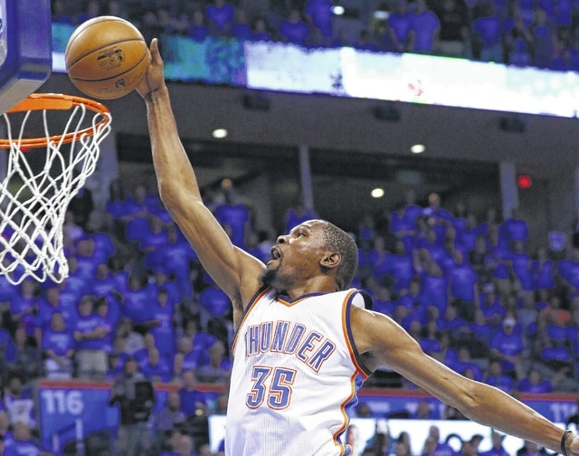 Oklahoma City Thunder forward Kevin Durant (35) dunks in the first quarter of Game 6 of a second-round NBA playoff series against the San Antonio Spurs in Oklahoma City on Thursday.