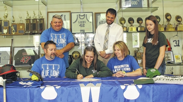 Brooklyn Wilson, a member of the graduating class of 2016 at Washington High School, signs a letter of intent to play softball at Bethany College. Wilson (seated at center), is flanked by her parents, Mark and Jasine and is joined by (standing, l-r); Randy Elzey, Washington High School softball coach; Jon Creamer, WHS Athletic Director and her sister, Brittany Wilson.