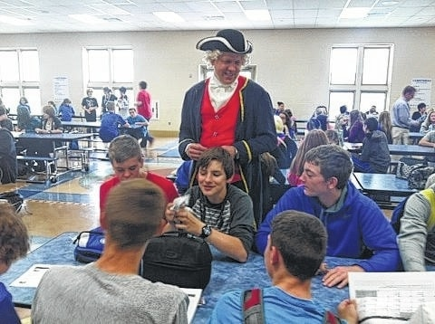 """Washington Middle School celebrated Right to Read Week, May 9-13, with many fun activities for the students. The theme for the week was """"Washington fought for our Freedom."""" Superintendent Matthew McCorkle visited students during lunch times dressed as President George Washington to pass out raffle tickets to students who were caught reading. Students were then able to turn in their tickets for free books and a chance to win various food prizes."""