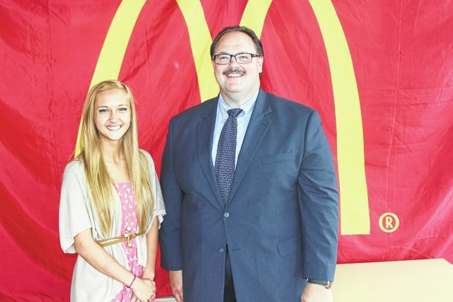 Julia Barrett, a Miami Trace High School senior, was recently presented with a $2,500 McDonald's National Employee Scholarship Award. Nick Epifano, owner of the local McDonald's, made the presentation.