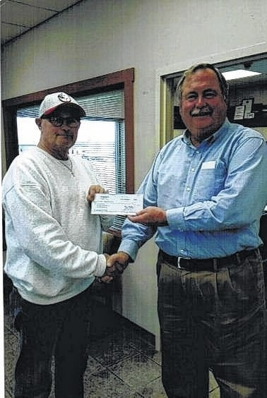 Fayette Aerie 423 Fraternal Order of Eagles has sponsored a Little League team for over 40 years. From left to right, Past Worthy President Danny Coe and John Merriweather of the Little League Association.