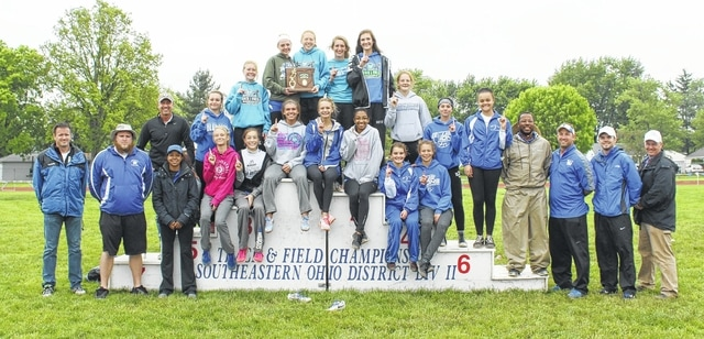 The Washington Lady Blue Lion track team and coaches following the win of the Division II District title Saturday, May 21, 2016. It is the program's 2nd District title in the last three years and sixth in the past 13 seasons.