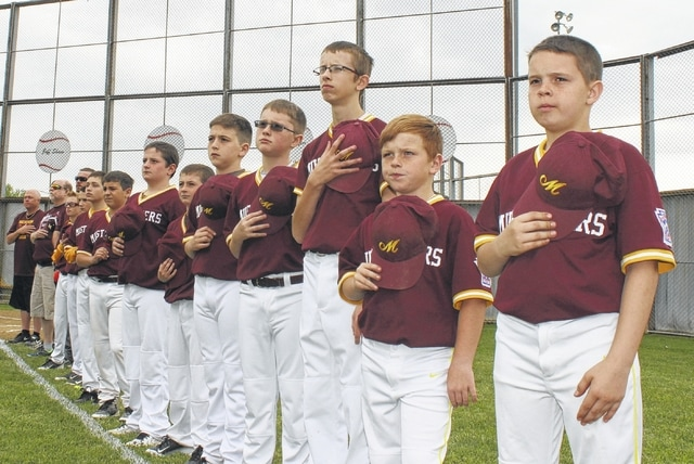 Saturday was the 62nd-annual opening day for the Washington C.H. Little League. Above, members of the Mustangers team honor America during the National Anthem.