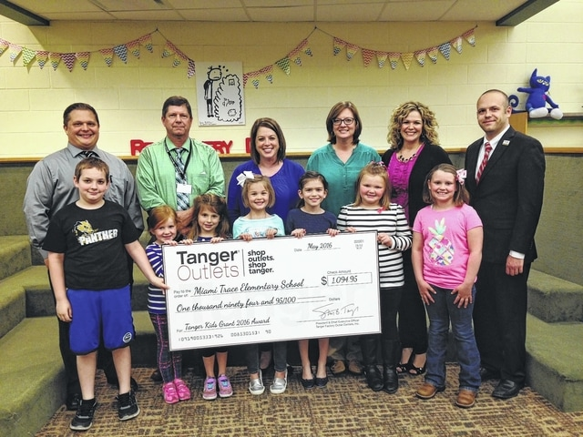 From left to right, Ryan Davis Miami Trace Elementary School assistant principal, Jeff Conroy, Miami Trace Elementary School principal, Krissy Cooper, Miami Trace Elementary School teacher, Carrie Walton, Miami Trace Elementary School teacher, Kristen Hauer, Tanger Outlets general manager, and Andy Gibson, Tanger Outlets assistant general manager.