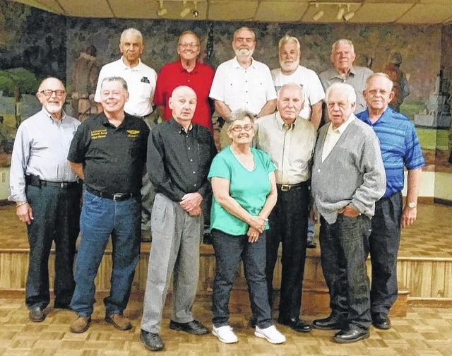 "Members of the Fayette County Honor Guard met recently for their annual dinner gathering. Back row, from left to right, Charles ""Buck"" Harris, John Mason, Bill Footy, Glenn Rankin and Tom Slager; front row, left to right, Paul Sands, Mike Curl, Dave Frederick, Patty Deweese, Ed Fisher, Eddie Wheaton and Sheldon Litton."