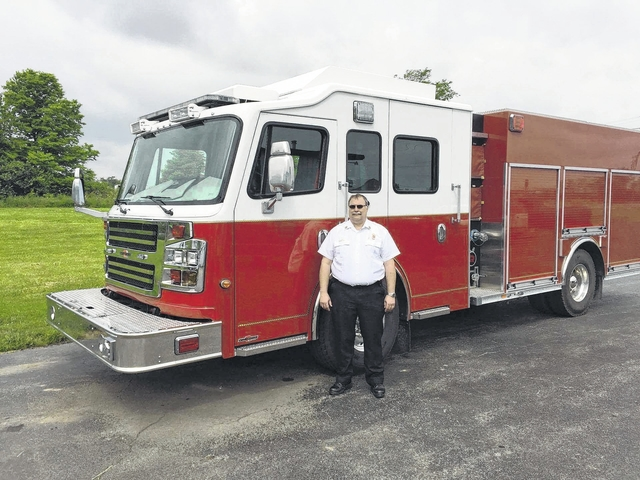 Washington C.H. Fire Department Chief Tom Youtz displays the city's new fire truck, a 2014 Rosenbauer purchased from All-American Fire Equipment. The multi-functional truck should be in service in about a month.