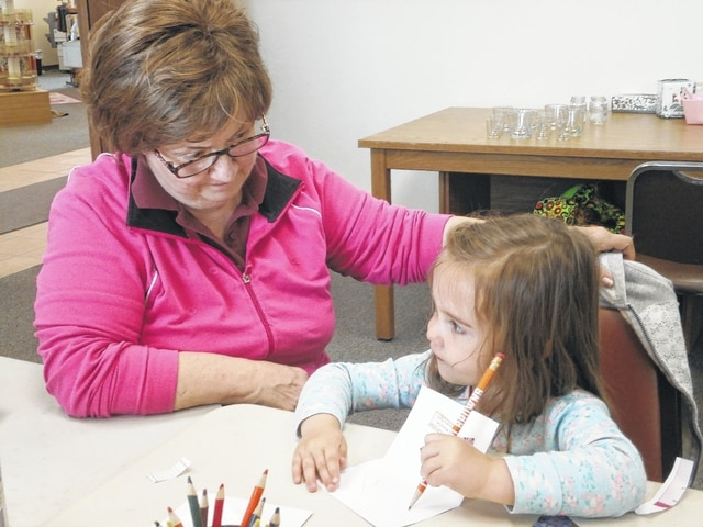 """Lynnlee (shown here with """"Grammy"""" Connie) enjoyed making a beautiful card and gift for mommy with Miss Linda at Jeffersonville Branch Library's Mother's Day Card and Craft Workshop recently."""