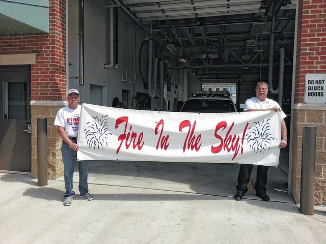 Dan Fowler (left), the president of Fire in the Sky, and Washington Fire Department Chief Tom Youtz are promoting the Fire in the Sky drive-thru donation event this Saturday.