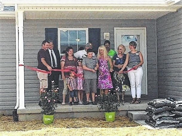 Community Action Commission of Fayette County (CACFC) celebrated National Homeownership Month on June 24 by hosting an open house at the newly constructed home of Damian (Scott) and Ashley Forsha and their children.