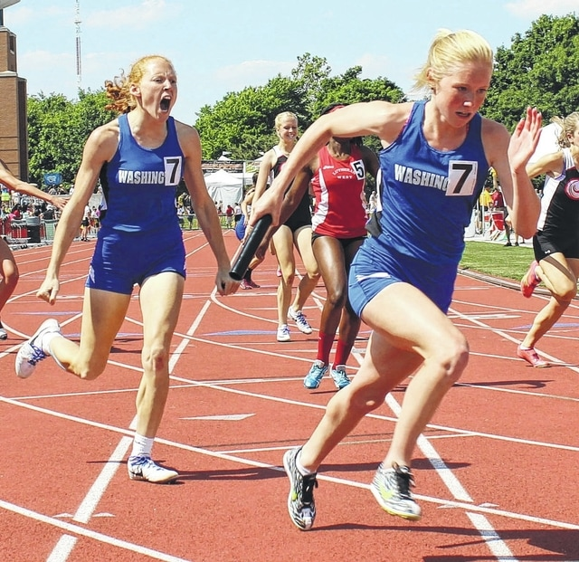Washington's Maddy Garrison (right) takes off with the baton with much encouragement from Alexis Gray during the semifinals of the 4 x 400-meter relay at the Division II State track meet Friday, June 3, 2016 at the Jesse Owens Memorial Track at The Ohio State University.