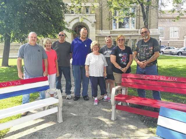 The VFW Post 3762 recently donated benches to the Washington School Apartments for the residents to enjoy. Bud Williams of the VFW made and painted the benches and the fasteners were donated by A&M Fasteners LLC. Pictured are VFW Auxiliary Post 3762 members, left to right: back row: Tracy Patterson, Jo Frederick, Ronald Gabbert, Chad VanMeter, Missy Schablin, Jeri Gabbert and Mike Slocum (VFWR). Front (middle): Washington School resident Deborah Fox.