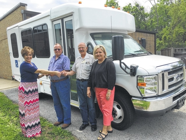 The Fayette County Commission On Aging received a 5310 grant that helped to provide a majority of the funding to help the center purchase a much needed bus to transport the senior citizens of Fayette County. Cheryl Stockwell, the director of the center, is shown here giving the keys of the new bus to transportation drivers, John Morris, Paul Edgington and transportation supervisor Lori Bach. If you are 60 years of age or older, the COA can provide transportation for you in Fayette County. It is a $1 each-way suggested donation and you must reserve your ride 24 hours in advance at 335-2159.