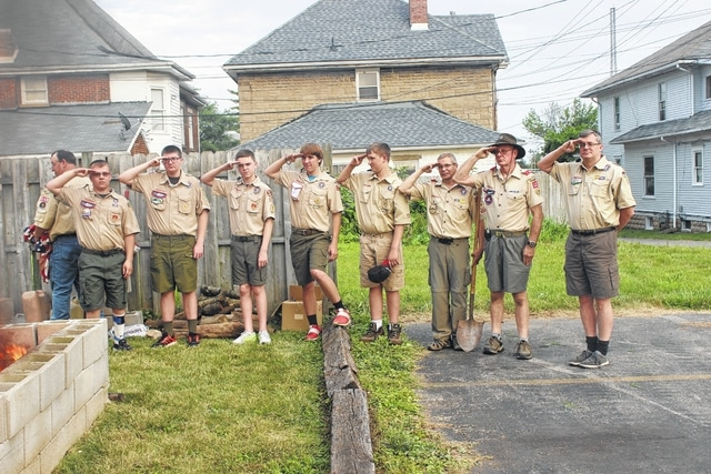 The Washington Court House Boy Scout Troop 112 retired 46 flags on Flag Day as part of their scout training across from First Presbyterian Church Tuesday.