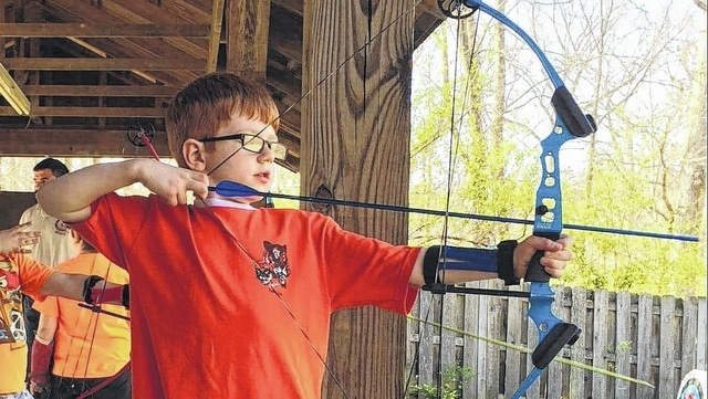 Cub Scout Ethan Lucas, 8, handles a bow with skill during archery at Camp Lazarus BSA Camp in Delaware, Ohio. Lucas is the son of Sheen Huseby and Chris Lucas of Washington C.H. A member of pack 5112, Lucas was at the rank of Tiger when this photo was taken April 17 at the Romp & Stomp Overnight and is now working on a Wolf rank.