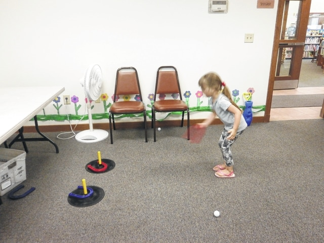 """Jeffersonville Branch Library was the place to be recently with its Indoor Games. Gabriella Webb attended and played horseshoes. The library also kicked off its 2016 Summer Reading Program """"Ready, Set READ."""" Come by the Carnegie Public Library in Washington Court House or visit Jeffersonville Branch Library today and sign up."""