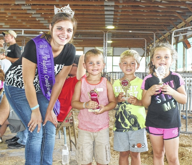 On the final day of the fair, Saturday, July 23, 2016, the pedal pull competition was held. Forty-one children ages 4 to 11 took part. Above are the top three place winners in the 4-year-old category joined by 2016 Fayette County Jr. Fair Queen Bethany Reiterman (l-r); Cooper Hughes, 1st; Nicholas Martig, 2nd and Kyah Tyree, 3rd.