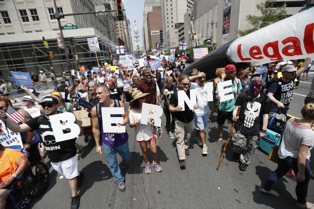 Supporters of Sen. Bernie Sanders march during a protest in downtown Philadelphia on, Monday, July 25, 2016, during the first day of the Democratic National Convention. (AP Photo/John Minchillo)