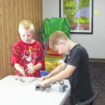 Lego builders construct towers and cars