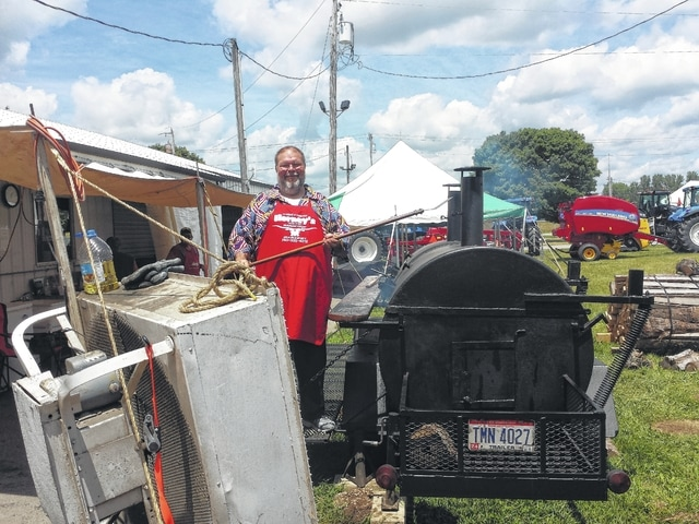 Harry Wright, a local radio personality, volunteered as a griller on Saturday of the 2016 Fayette County Fair for the Cattle Feeders Corral.