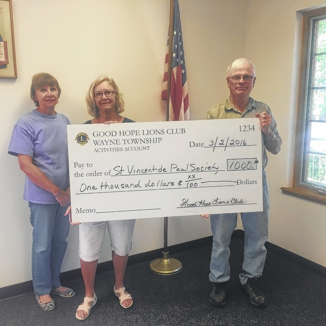 Sue Mowery and Jana Deeks, members of the Saint Vincent de Paul Society, receive a donation from Jim Garland, on behalf of the Good Hope Lions Club, for $1,000 to help the needy in the county.