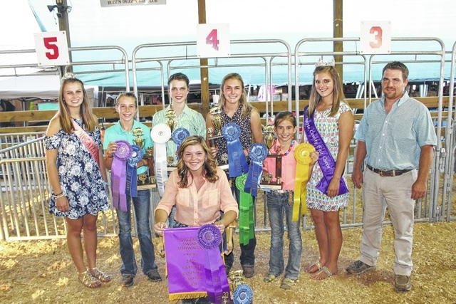 Kendal May (front) won the overall swine showmanship prize Tuesday at the Fayette County Junior Fair. Also in the picture are Fayette County Pork Queen Hannah Casto, second place Aubrey McCoy, third place Faith Holloway, fifth place Tori Evans, fourth place Emily Reeves, Fayette County Fair Queen Bethany Reiterman, and Brian Down, judge of the swine showmanship contest.