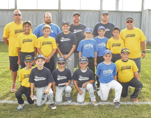 The National squad, above, won the Washington C.H. Little League's Minor Division all-star game, 16-15 Monday, July 18, 2016 over the American team. The team is pictured prior to the game on the field at Lewis Street. (front, l-r); Aiden Osborne, Cooper Robertson, Brayden Feibelkorn, Jameson Hyer, Lafe Coleman, Cameron Morton; (second row, l-r); Lydia Gibson, Kobie Hyer, Ethan Turley, Cooper Enochs, Ian Spiess, Cody Moore; (back, l-r); coaches Josh Morton, Jimmy Enochs, Jeremy Hyer, Aaron Robertson and Steve Osborne.