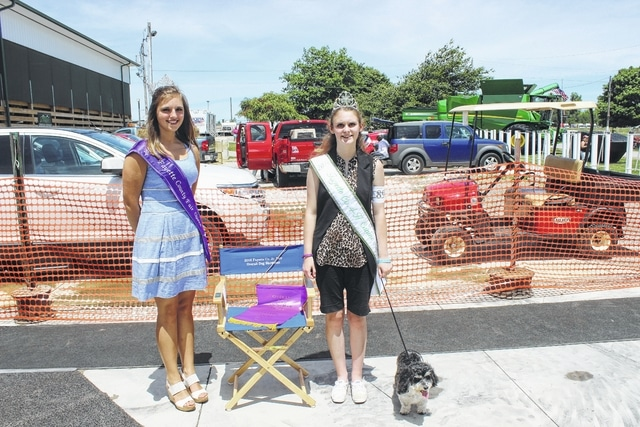 Summer Hurles (right), with her dog Molly, was named the Overall Dog Showman at Monday's Fayette County Junior Fair Dog Show. She is pictured with 2016 Fayette County Fair Queen Bethany Reiterman.