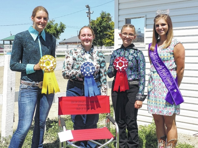 The 2016 Junior Fair Horse Versatility Show was held on Tuesday morning at the horse arena. Pictured (L to R) are the senior class winners with the Fayette County Fair Queen Bethany Reiterman: Faith Kobel, third place; Taylor Perkins, first place and Skylynn Barden, second place. Chair sponsored by Triple M. Farms.