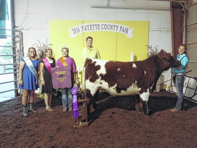 Victoria Waits was selected as the 2016 Jr. Fair Grand Champion Beef Steer after the show on Tuesday afternoon. She is pictured with attendant Alexis Schwartz, first attendant Virginia Schappacher, beef queen McKenzie Riley and judge Leroy Billman.
