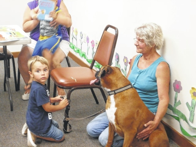 Grammy Kay and Landon Smith brought their dog Ginger to the story hour for the pet parade.