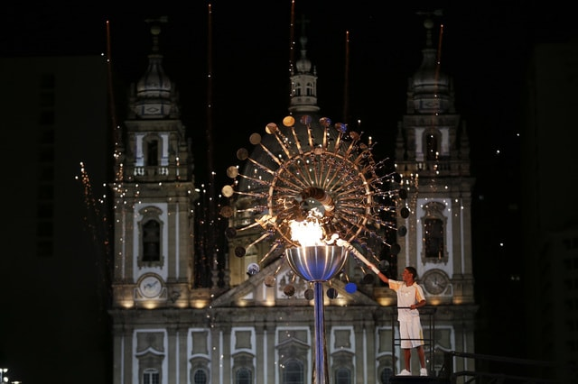 Jorge Alberto Oliveira Gomes lights the Olympic cauldron during the opening ceremony of the 2016 Summer Olympics in Rio de Janeiro, Brazil, Saturday, Aug. 6, 2016. (AP Photo/Natacha Pisarenko)
